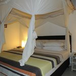 Four poster bed with mosquito nets