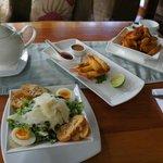 Afternoon tea of Caesar salad, prawn rolls, potato skins