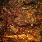 pies de cerdo estofados con butifarra, garbanzos y cigalas