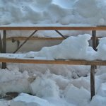 picnic table outside of reception, covered in snow