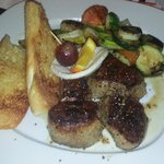 Pork steak with grilled vagetables and Garlic bread