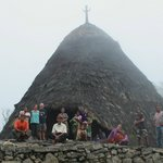 Together with Wae Rebo people in front of mBaru Niang (traditional house)