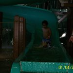 Little guy coming down the big slide.  Feeling so proud of himself!