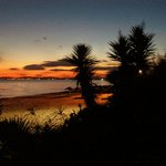 sunset over beach at sindbad hotel