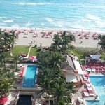 View from room's balcony of pools, beach and grille