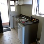 Kitchenette area - tea/coffee/kettle, minibar with fresh milk, toaster, plates