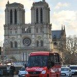 Paris Panoramic Tour bus leaving Notre Dame Cathedral