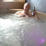 enjoying the hot tub in sunset cottage