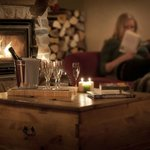 Snuggle up with a glass and book in front of the fire