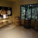 Variety of casks and window to bottling hall