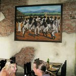 paintings of plantations life decorate the restaurant