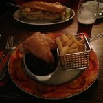 Hearty pie and huge fish behind