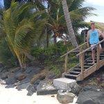 Muri Beach Hideaway steps down to beach beside Unit 1