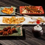 Selection of tapas and yakitori dishes