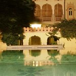 The above ground pool in the courtyard, taken at night time