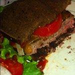 Medium rare cheddar cheeseburger on rye