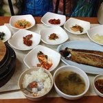 Rice, side dishes, fish, and the clay pot