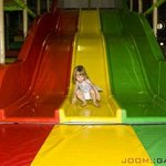 The slides in the giant jungle gym