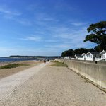 Beach and walkway to the quay from the caravan lodge area at Sandhills Holiday