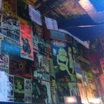 Vintage rock posters decorate the walls