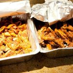 Carryout meal- plantains, fried fish, ribs