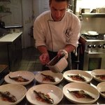 Chef Alex prepping sardines from Sardinia for the nights Chef's Table experien