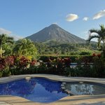 Pool and gardens with Arenal Volcano in background
