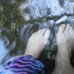 my feet in the pool of the falls on property; the reflections on the water swi