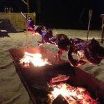 roast duck over open fire on beach