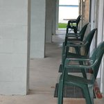 Chairs outside each room