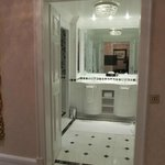 Bathroom, complete with chandelier, ring holder, TV, whirlpool tub and rain forest shower. LOVE