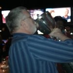 Sipping champagne from the Grey Cup