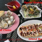 Trio of Appetizers. Clams, Oysters and Island Bread.