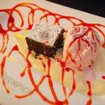chocolate cake, homemade strawberry ice cream, sauce anglaise, strawberry drizzle