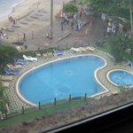 View of pool and beach from the room