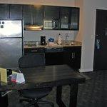 kitchen/desk eating area next to entry