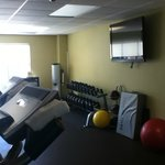 fitness room TV and weights and such