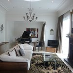 The room with baby grand piano.