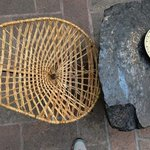 handwoven chair in courtyard