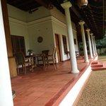 red verandah runs around the house