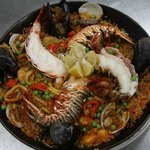 Paella with lobster tail