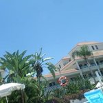 relaxing by the pool enjoying the clear blue sky & sunshine