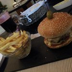 Delicious hamburger with homemade chips and mulled wine