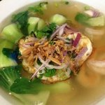 Chicken and Shrimp egg noodle soup with bok choy and a fried egg