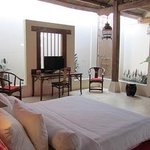 Shikumen Suite Romantic honeymoon suite with luxurious bed centre stage.