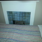 Bed right next to open chimney