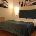 Cool art work, comfy bed, first class linens