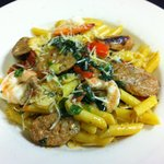 Penne pasta with fresh Mahi, scallops, shrimp in a herb butter sauce.