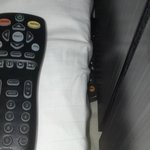 Extra remote behind bed.