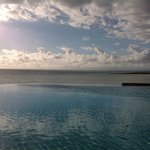 Infinity pool that is right on the water facing the sunset.
